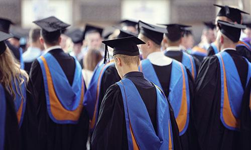 https://exportpulse.com/wp-content/uploads/2021/04/graduates-back-view.jpg
